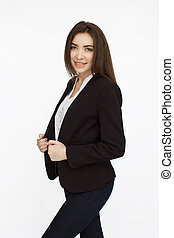 Young successfull businesswoman posing on camera on isolated background