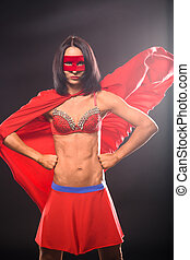 Young super hero woman in studio