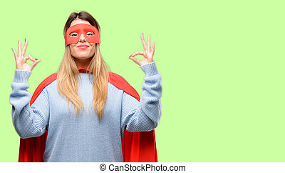 Young super woman doing ok sign gesture with both hands expressing meditation and relaxation