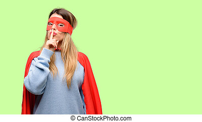 Young super woman with index finger on lips, ask to be quiet. Silence and secret concept