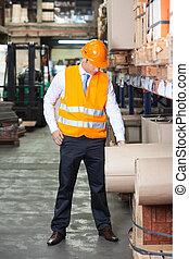Young Supervisor At Warehouse