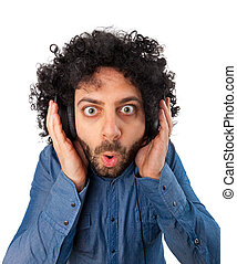 Young surprised man with headphones