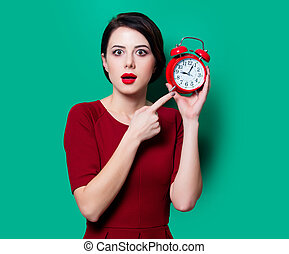 young surprised woman with alarm clock