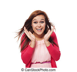 Young surprised woman with hand next to her face