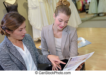 young tailor woman talking to client