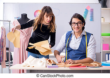 Young tailors working in workshop
