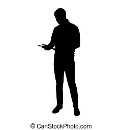 Young tall man standing and holding tablet in his hands, vector silhouette