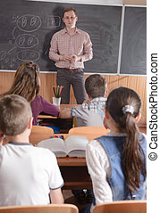 Young teacher in front of class