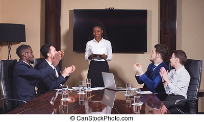 Young team applause in meeting during successful...