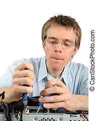 Young technician repairing a PC