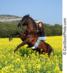 young teen and her rearing stallion