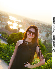 Teen at sunset in Florence, Ponte Vecchio on the background.