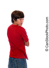 a young teen boy in a red shirt looking backward over his shoulder isolated on white