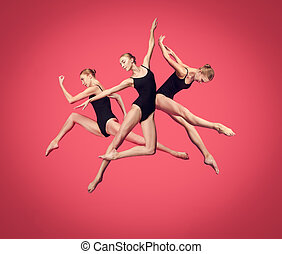 Young teen dancer on red studio background.