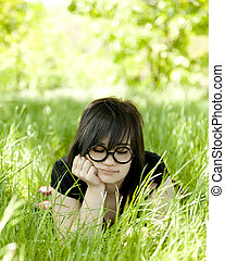 Young teen girl at green grass.