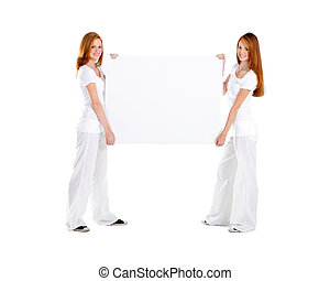 young teen girl holding white board