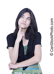 Young teen girl looking up, thinking, finger to chin