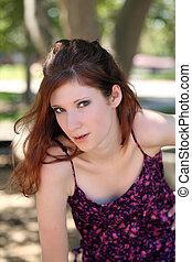 Young teen girl outdoor portrait purple top