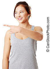 Young teen girl pointing on left