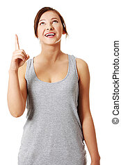Young teen girl pointing on something above her