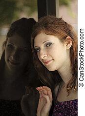 Young Teen Girl Portrait Reflected In Window