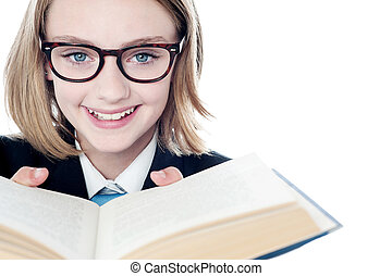 Young teen girl reading a book