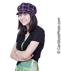 Young teen girl smiling, arms crossed, wearing hat