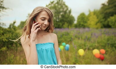 Young teen girl talking on the phone