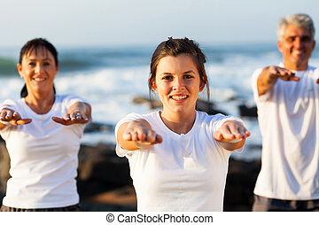 young teen girl training her parents at the beach