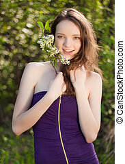 young teen girl with flower outdoor