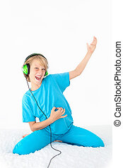 young teen kid playing air guitar