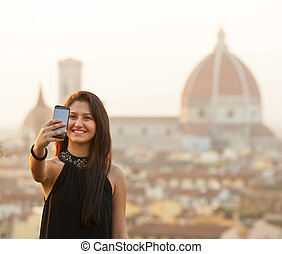 Young Teen takes a selfie at sunset in Florence