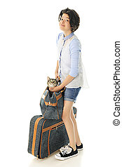 Young Teen Traveling with Kitty