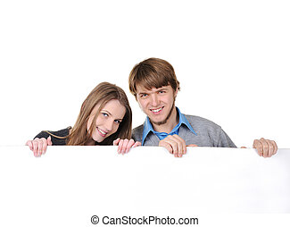 Young teenage couple holding bilboard