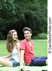 Young teenage couple in the park