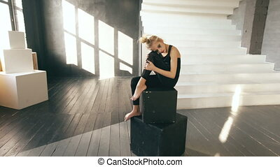 Young teenage girl dancer crying after loss perfomance sit...