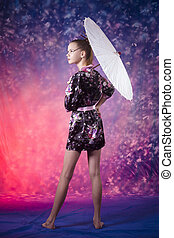 young teenage girl in floral kimono in studio