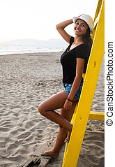 Young teenage girl on the beach at sunset
