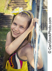 young teenage girl posing with a cute smile