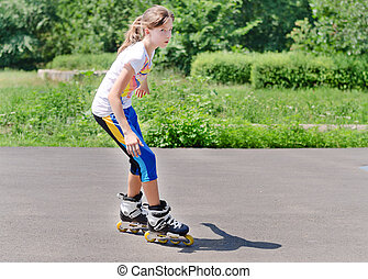 Young teenage girl rollerblading