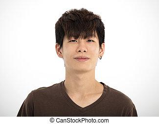 young  teenager boy looking at camera