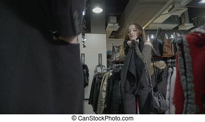 Young teenager daughter asking her dad to buy her a jacket...