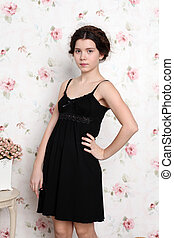 Young teenager girl black dress