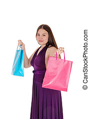 Young teenager girl holding up her shopping bags