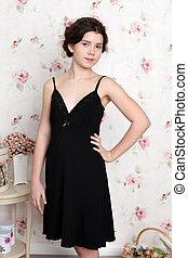 Young teenager girl in black pajamas