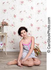 Young teenager girl in pajamas
