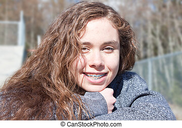 young teenager girl - a young teenage girl smiling directly...