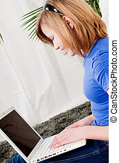 young teenager girl with laptop smilig