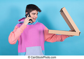 young teenager or student boy with mobile phone and pizza box isolated on background