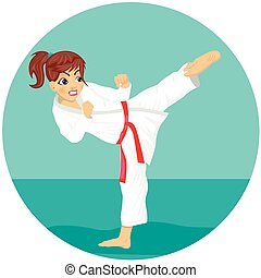 Young teenager red belt karate girl in kimono practicing kick exercise
